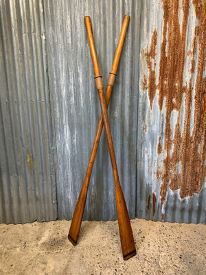 A pair of vintage wooden oars