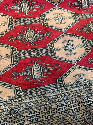 A large hand woven Jaldar red ground rectangular rug - pure virgin wool