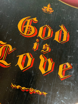 A hand-painted Victorian religious sign - God is Love