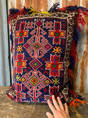 A rectangular red ground Persian carpet floor cushion