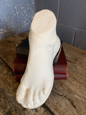 A neoclassical plaster foot of John Tussaud 1873