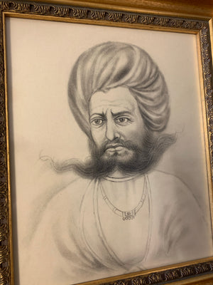 A framed pencil portrait of an Indian Rajasthani gentleman in a turban