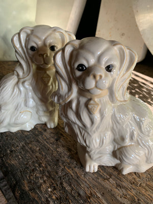 A pair of white ceramic Staffordshire style dogs