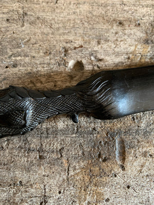 A Victorian carved ebony bird claw page turner