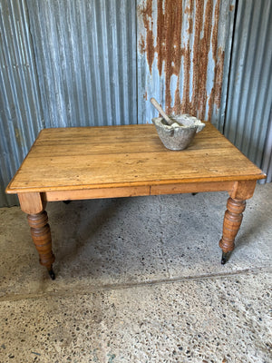 A Victorian scrubbed pine kitchen or dining table on castors