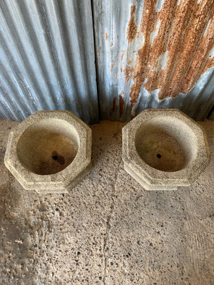 A pair of large Gothic font cast stone urns