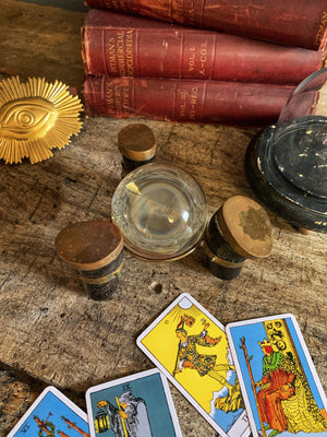 An unusual fortune teller's crystal ball on a brass and horn stand