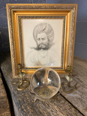 A fortune teller's crystal ball on a bronze stand