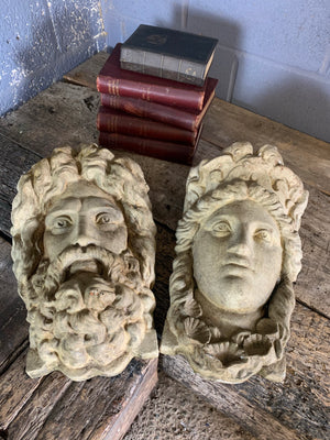 A pair of cast stone plaques of Neptune and Amphitrite