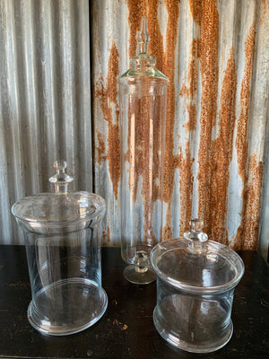 A collection of three large glass apothecary jars