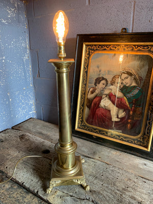 A brass column table lamp with lion paw feet