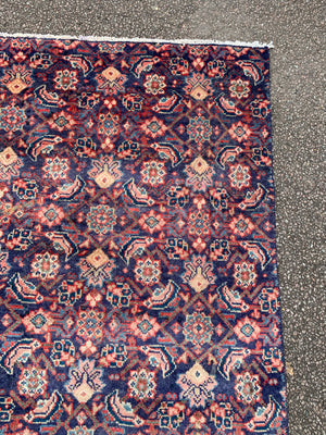 A large Persian blue ground rectangular rug