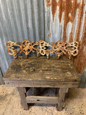A pair of white cast iron garden wall sconces
