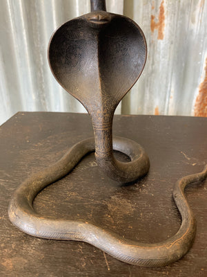 A pair of Indian or North African bronze cobra candlesticks