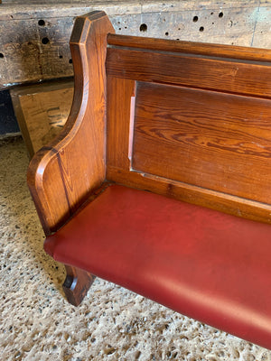 A 19th Century upholstered oak pew