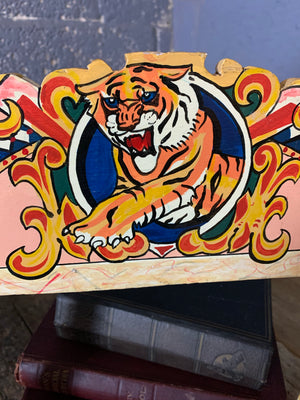 A hand-painted fairground style frame with tiger motif