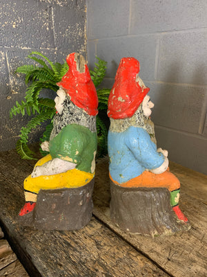 A large pair of cast stone gnome statues