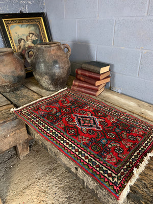 A small hand woven Persian red blue ground rectangular rug