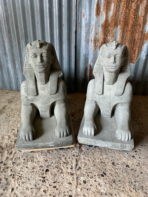 A pair of large cast stone Sphinx statues