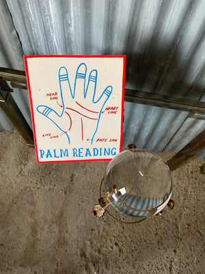 A fairground 'Palm Reading' sign