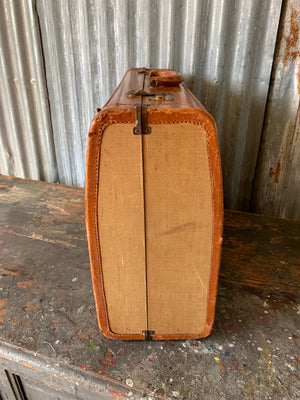 Tan leather and canvas suitcase with red water silk interior by Victor