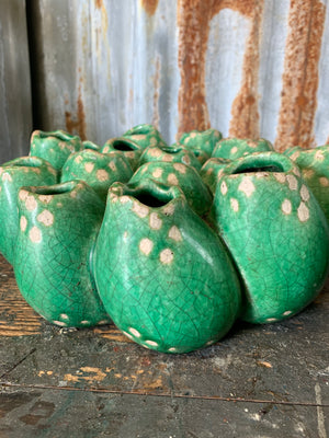 A green studio pottery coral form vase in the style of Pols Potten