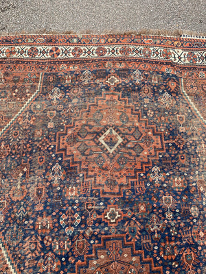 A very large hand woven Persian blue and orange rectangular rug- 300cm x 225cm