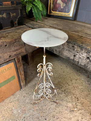A white cast iron garden wine table or stand