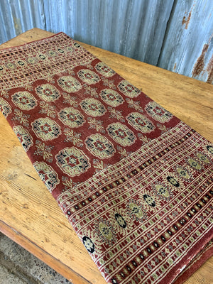 A kilim rectangular red rug