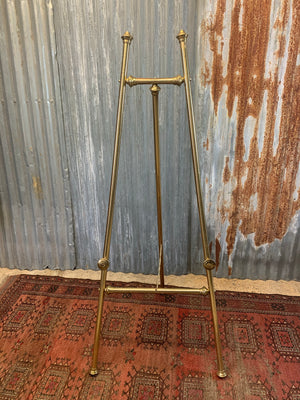 A brass full size floor standing display easel