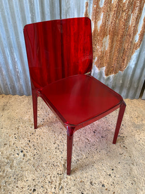 "A red Italian ""Blitz 640"" chair by Pedrali"