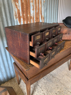 A wooden bank of 12 drawers