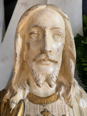 A plaster bust of Jesus with flaming Sacred Heart