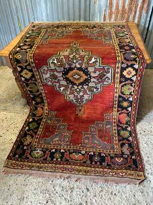 A large hand woven Persian red ground rectangular rug