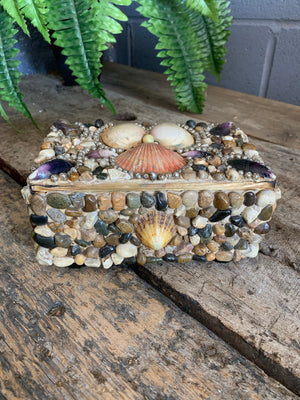 A medium seashell encrusted trinket box
