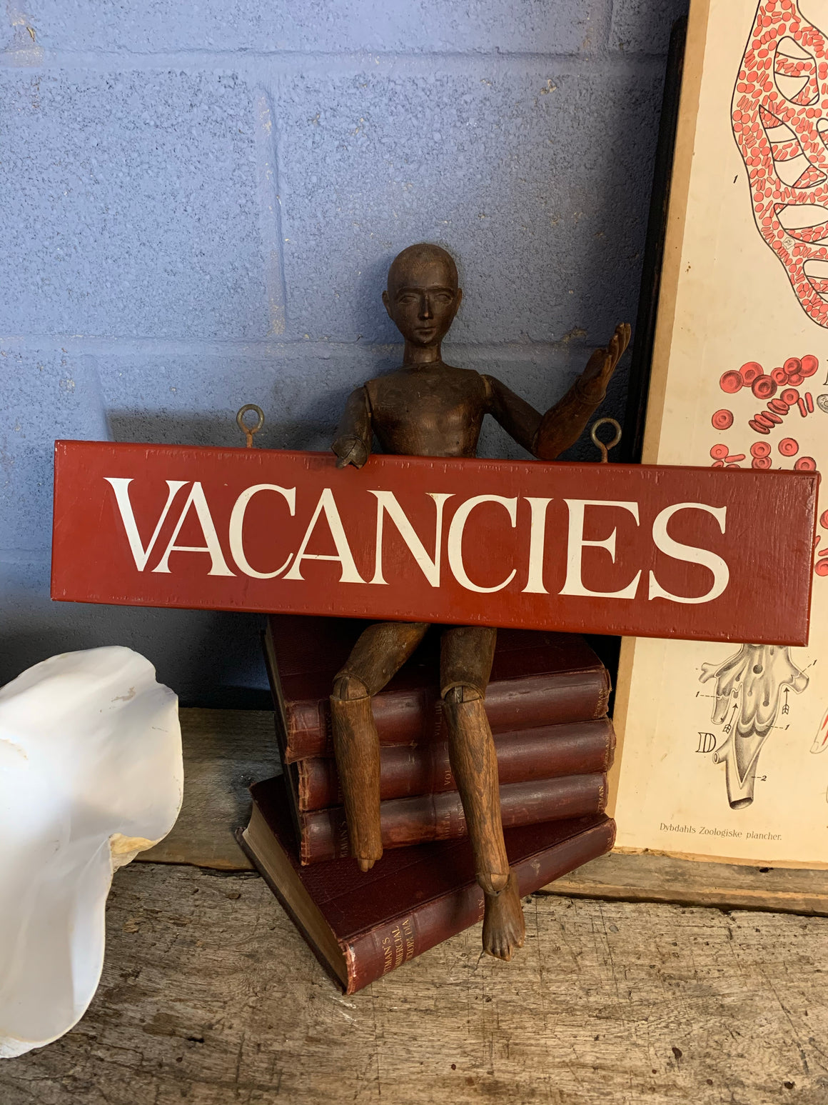 A hand painted wooden 'Vacancies' hotel sign