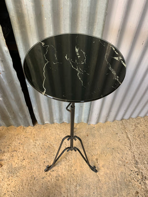 A black metal garden wine table or stand