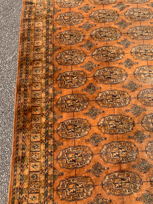 A very large gold ground Bokhara rug