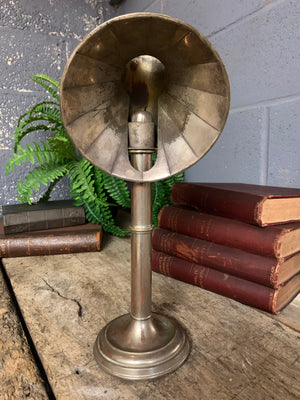 A student's lamp candlestick with parabolic shade
