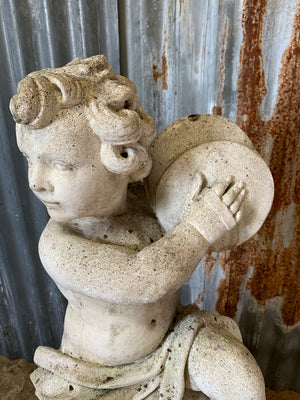 A cast stone musical putto garden statue - 88cm