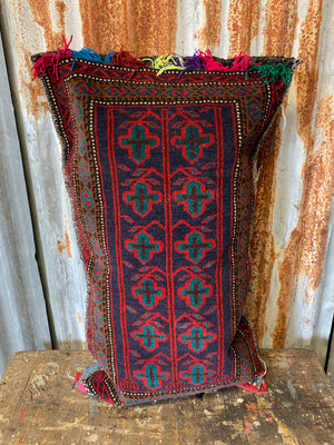 A large rectangular red ground Persian carpet floor cushion
