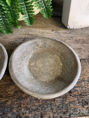 A pair of handmade rough hewn marble plates