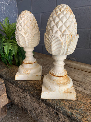 A pair of white cast iron acorn or pineapple finials