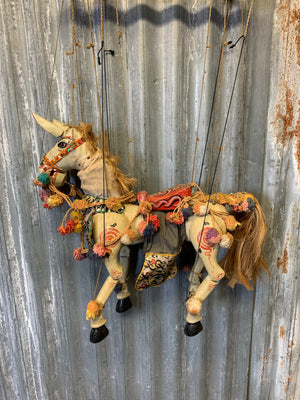 A large carved wooden horse puppet