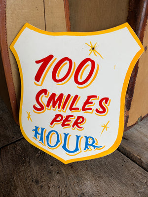 A hand painted fairground advertising sign - 100 Smiles per Hour