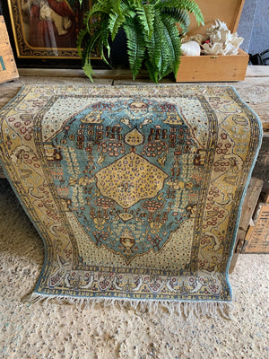 A hand woven Persian blue and yellow ground rectangular rug