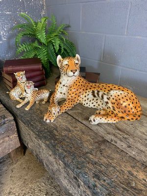 A ceramic mid-century cheetah and cubs statue set