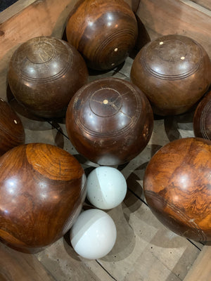 A set of eight wooden lignum vitae lawn bowls in a wooden box
