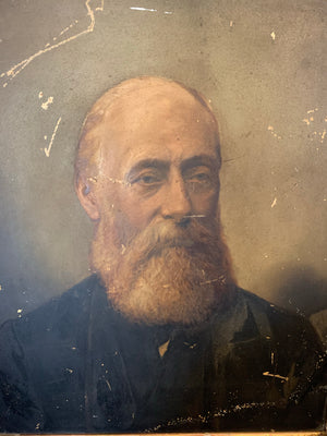 A Victorian oil painting of a bearded gentleman