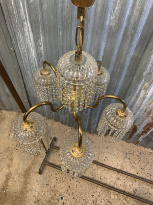 A five arm brass Hollywood Regency chandelier